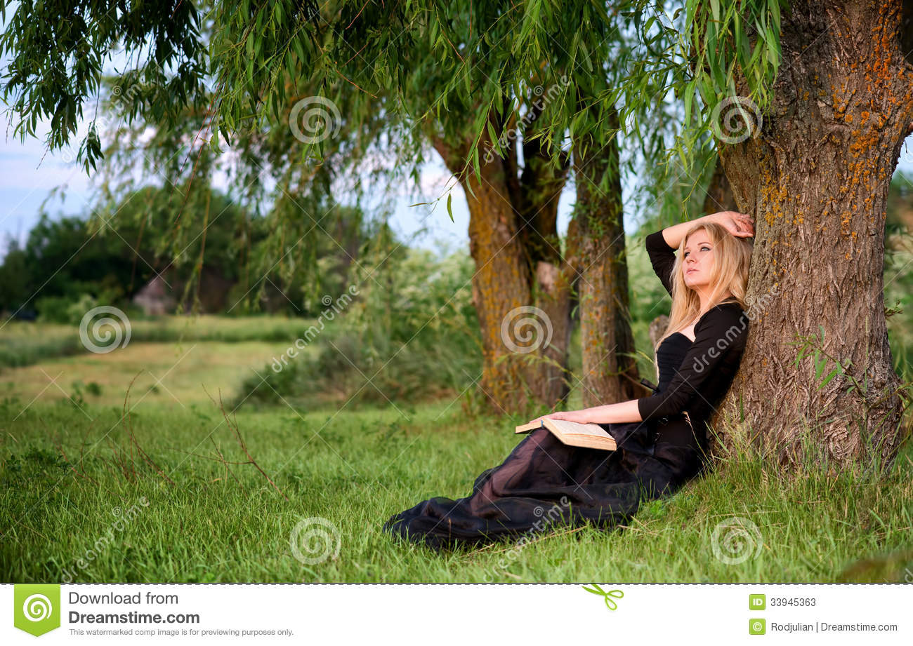 The girl sitting under the tree Stock Photo - People stock photo ...