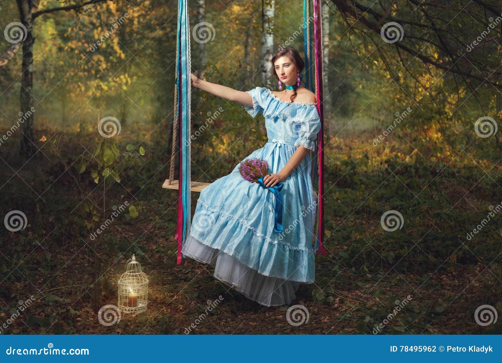 Sad woman on a swing.