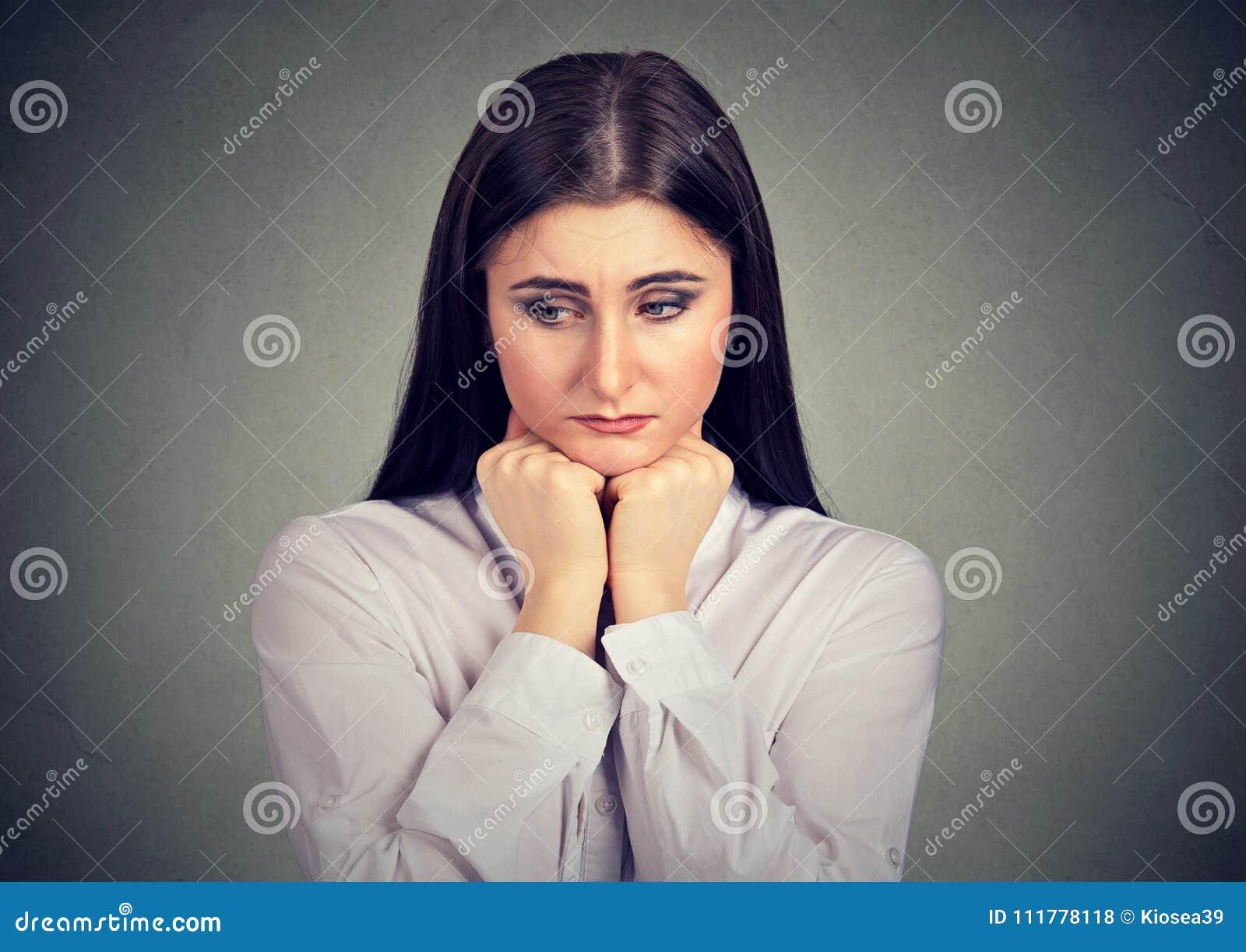 Sad youn girl looking melancholic