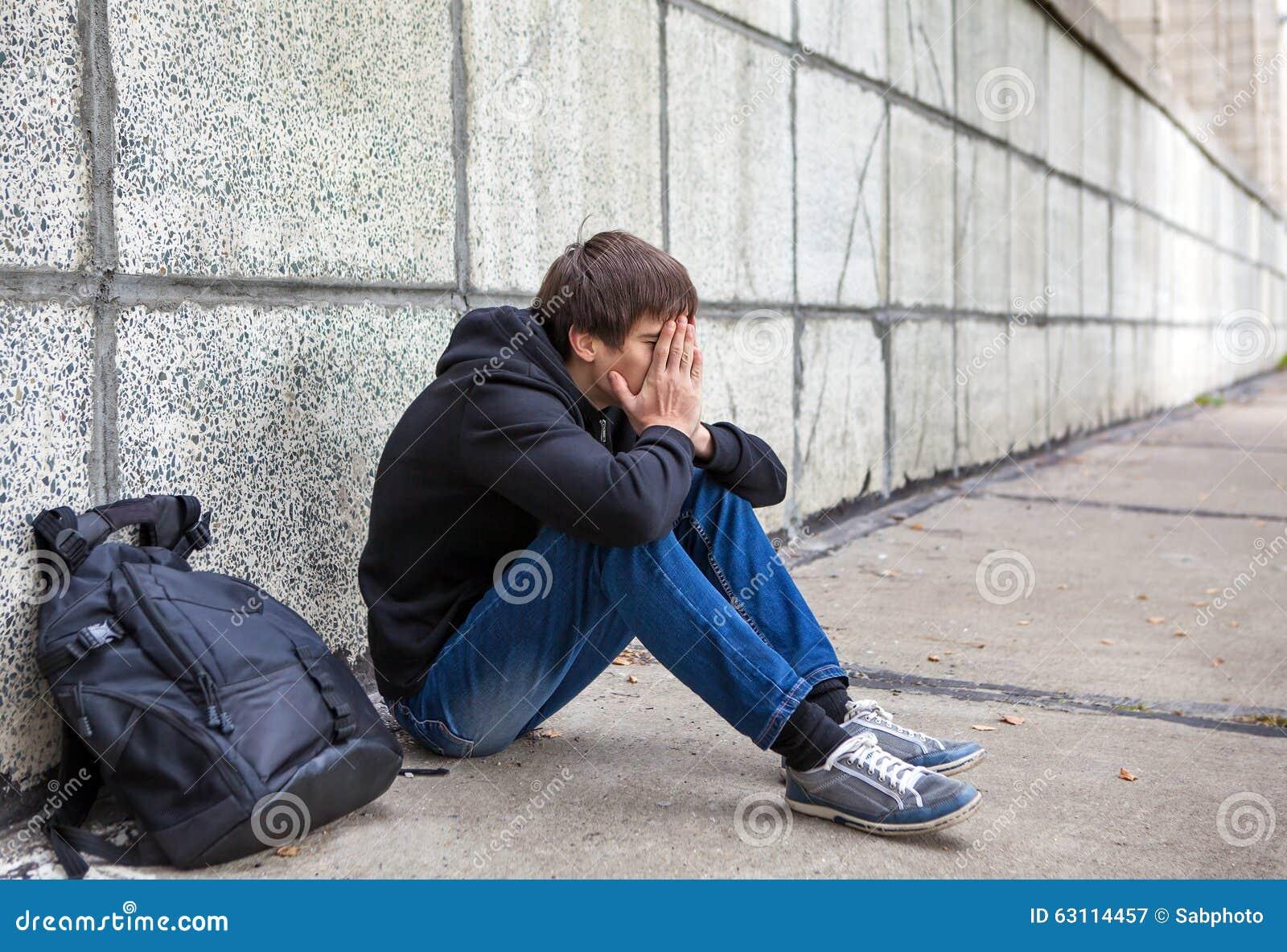 sad young man outdoor stock photo image 63114457. Black Bedroom Furniture Sets. Home Design Ideas