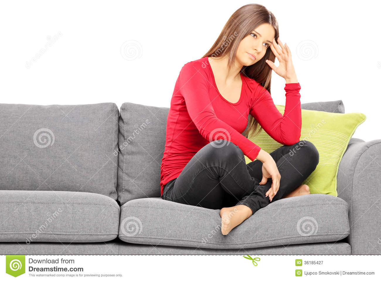 sad young woman sitting on a modern sofa stock image. Black Bedroom Furniture Sets. Home Design Ideas