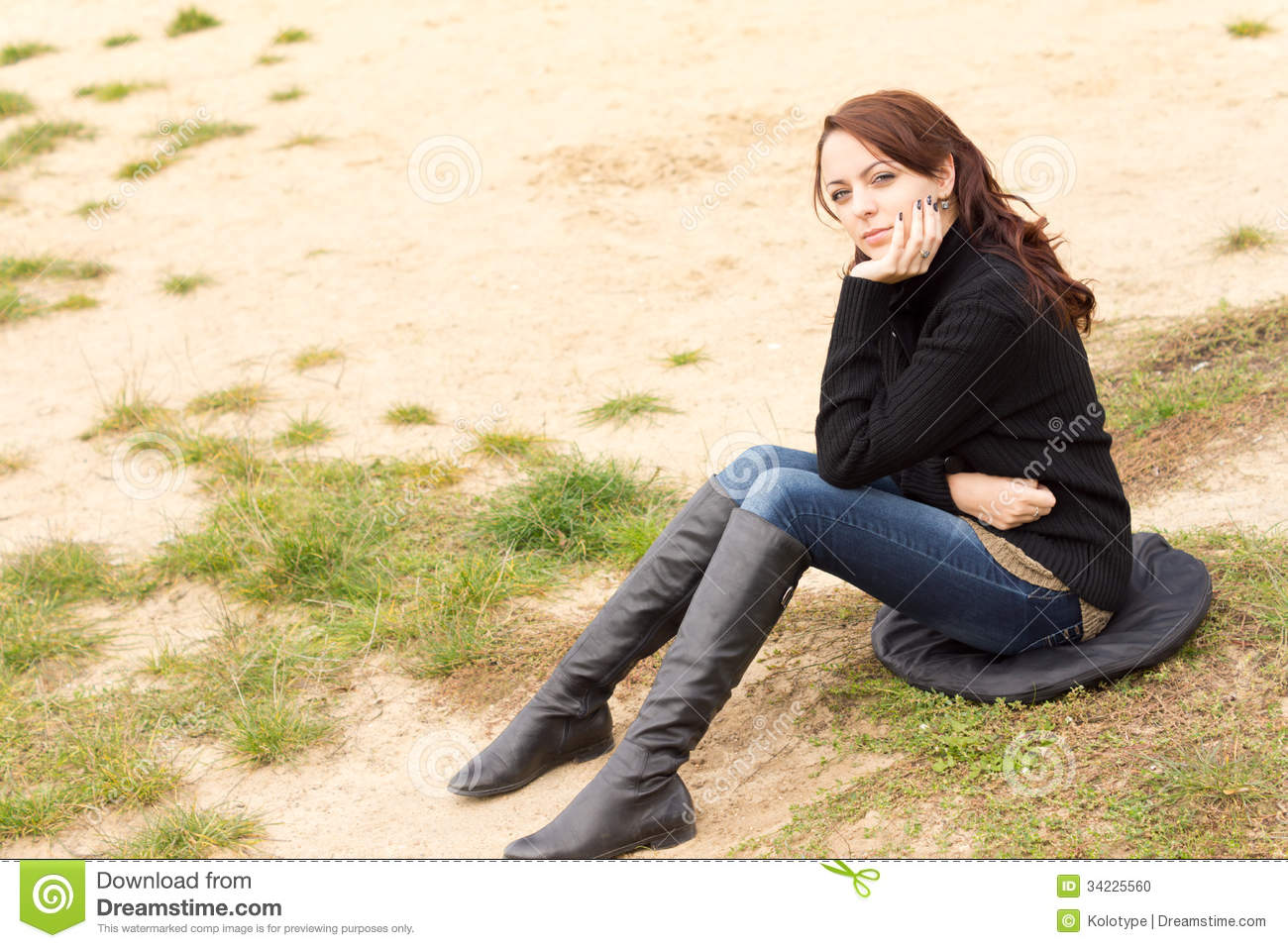 Girl sitting on the ground