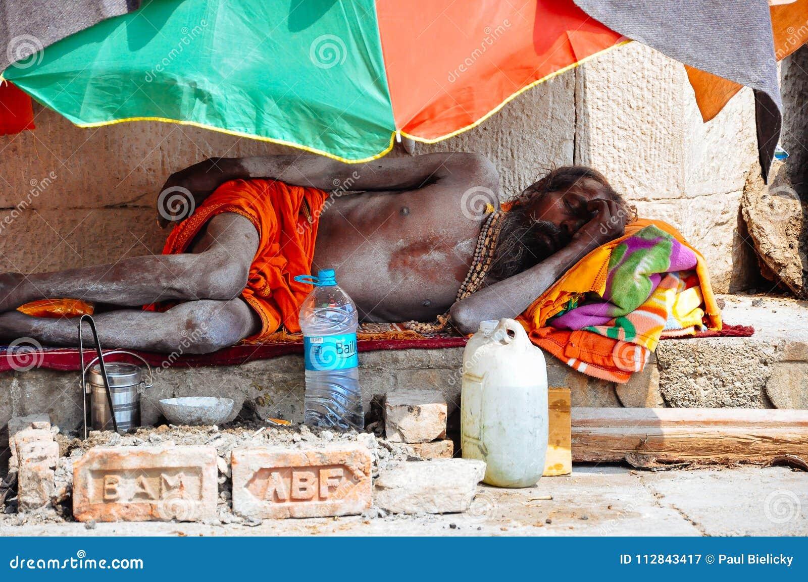 A sadhu sleeps in Varanasi, India.