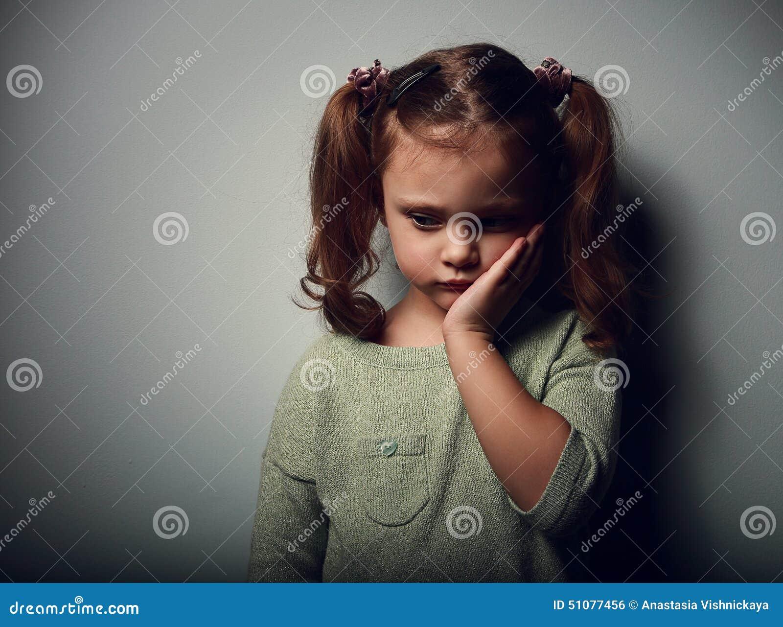 Sadness Kid Girl Looking Unhappy Closeup Portrait On Dark Stock Photo - Image 51077456-9304