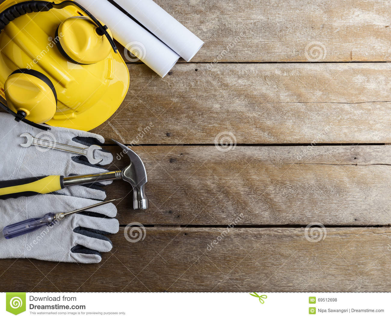 Safety equipment and tool kit on wooden background