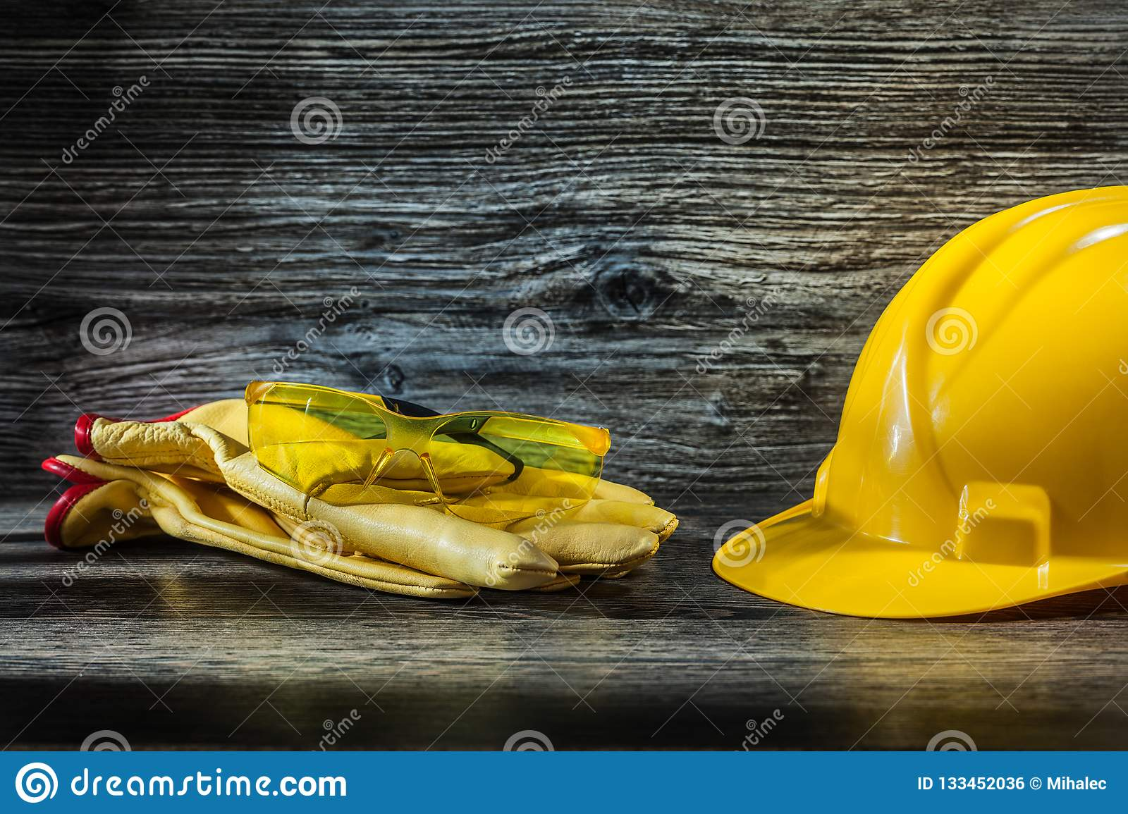 Safety glasses on working gloves and helmet
