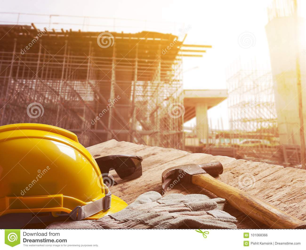 Safety helmet on table top with construction site in background