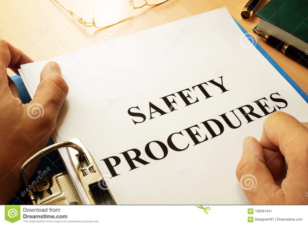 Safety procedures in a folder. Work Safety concept.