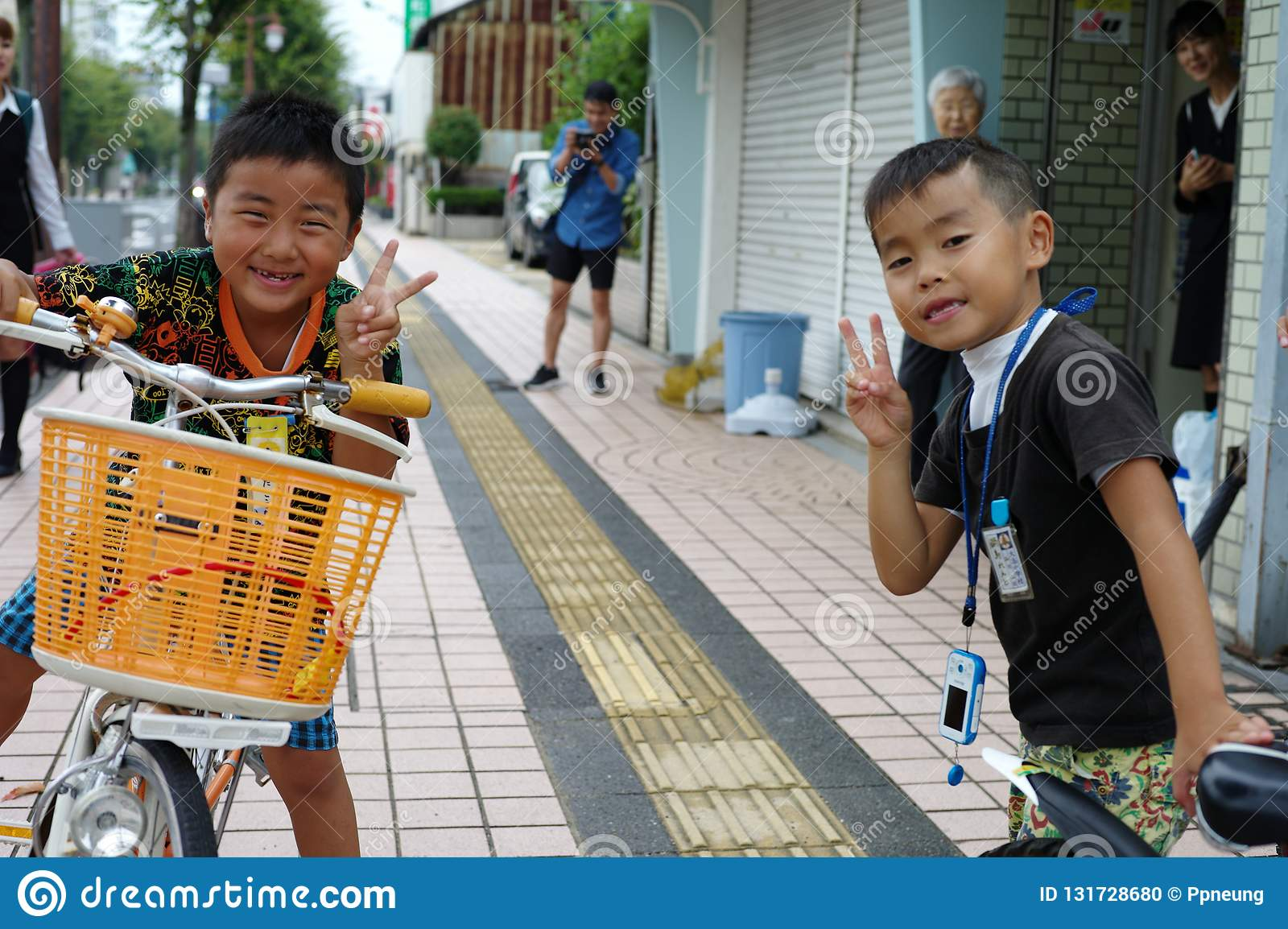 Saga, Japan:September 1,2018 - Portrait group of Japanese boys with their bicycles after school. Liefstyle of Japanese children in