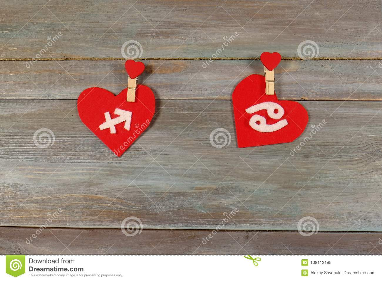 Sagittarius and cancer. signs of the zodiac and heart. wooden ba
