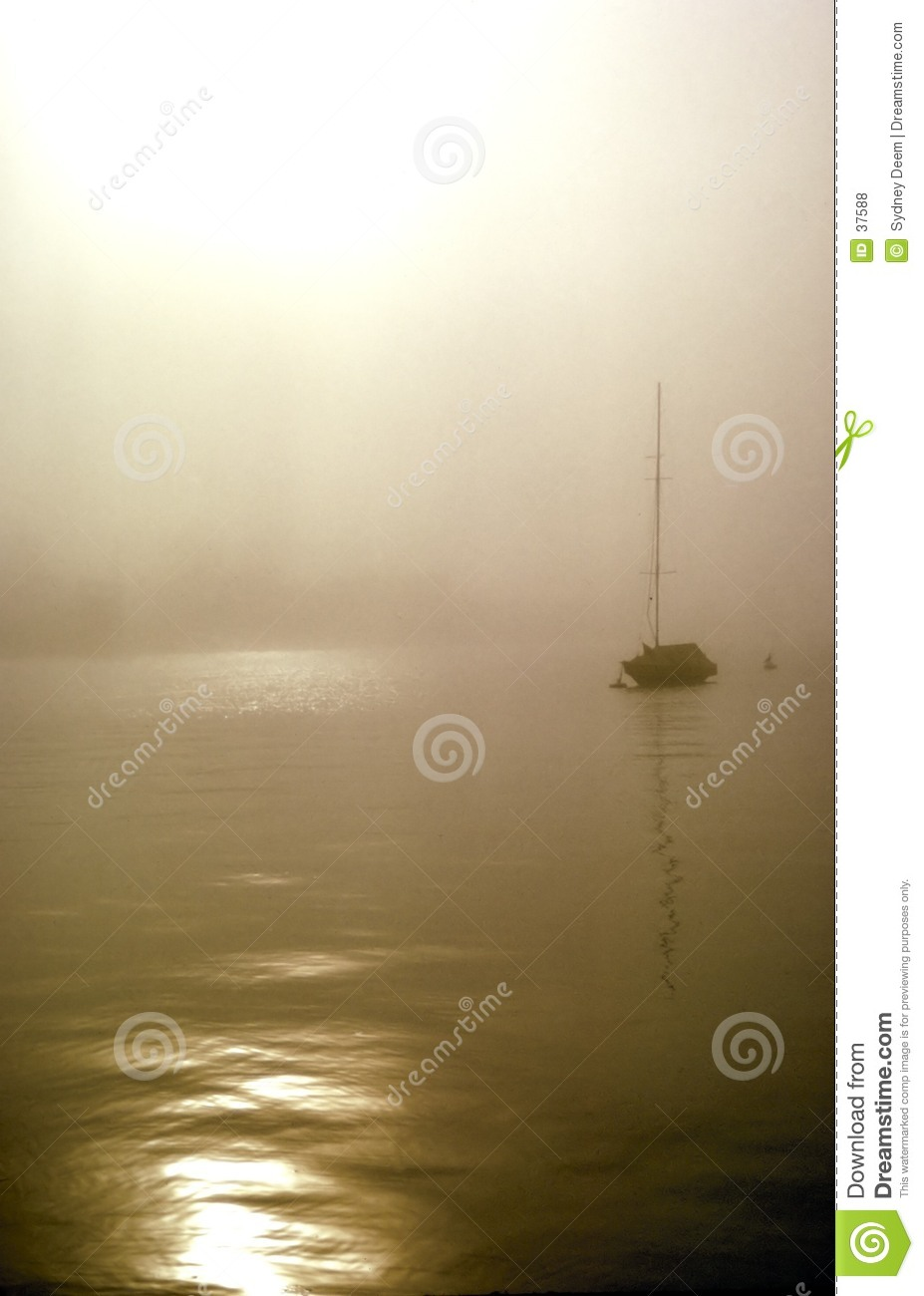Sail boat in the fog