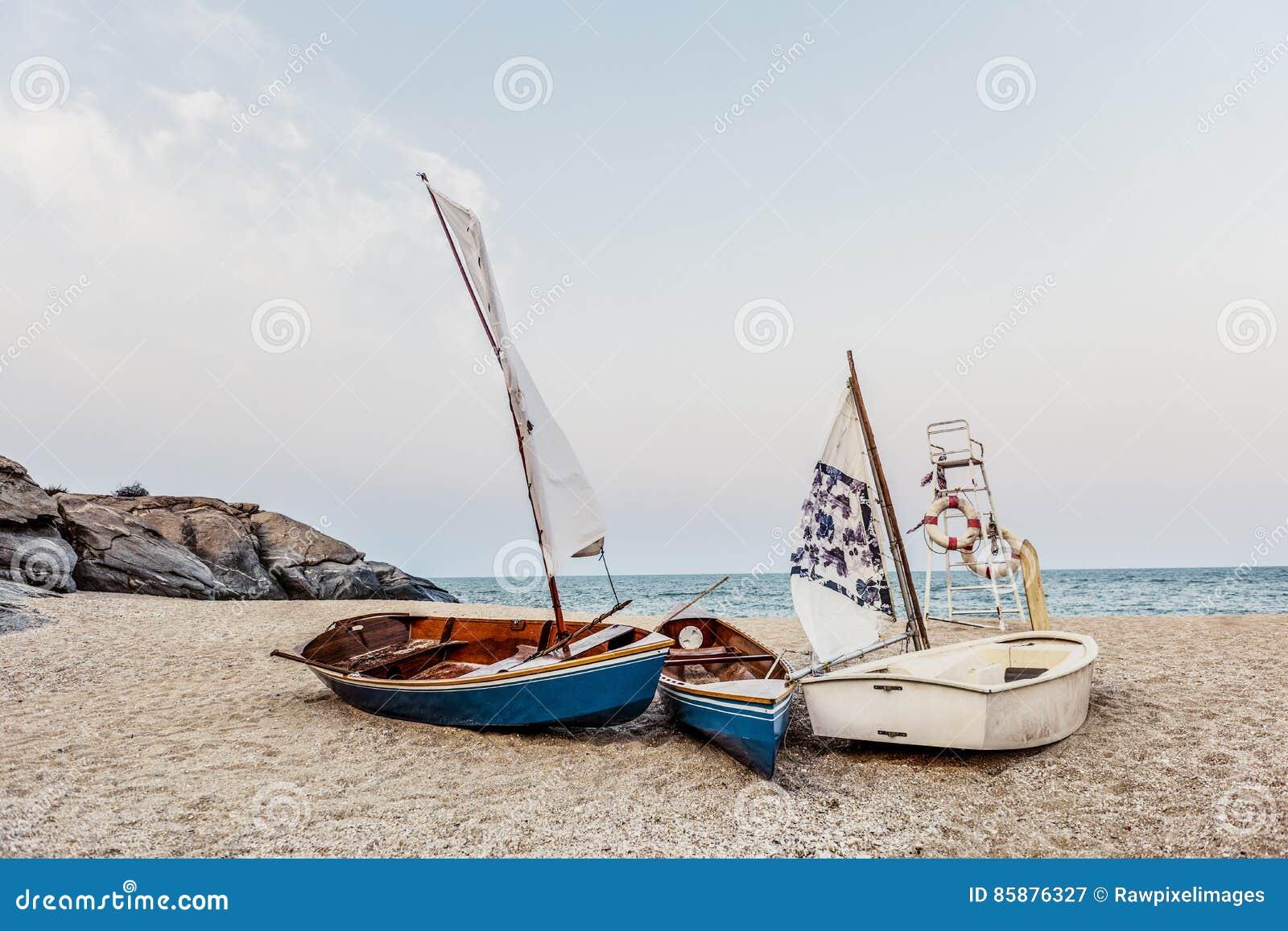 Sail Boats Sea Shore Lifesaver Flotation Life Buoy Rock Formation Concept