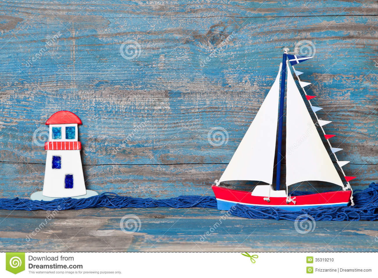 Sailboat And Lighthouse Decoration Stock Photo - Image: 35319210