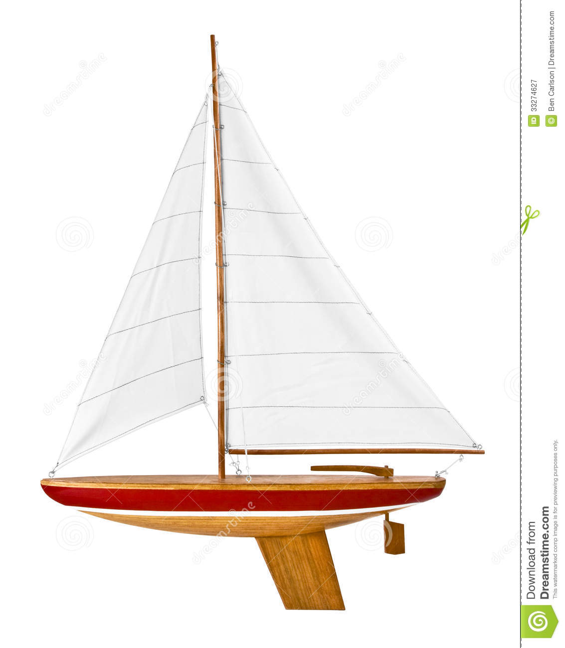 This is a wooden toy sailboat ready to put in the water and play. It ...