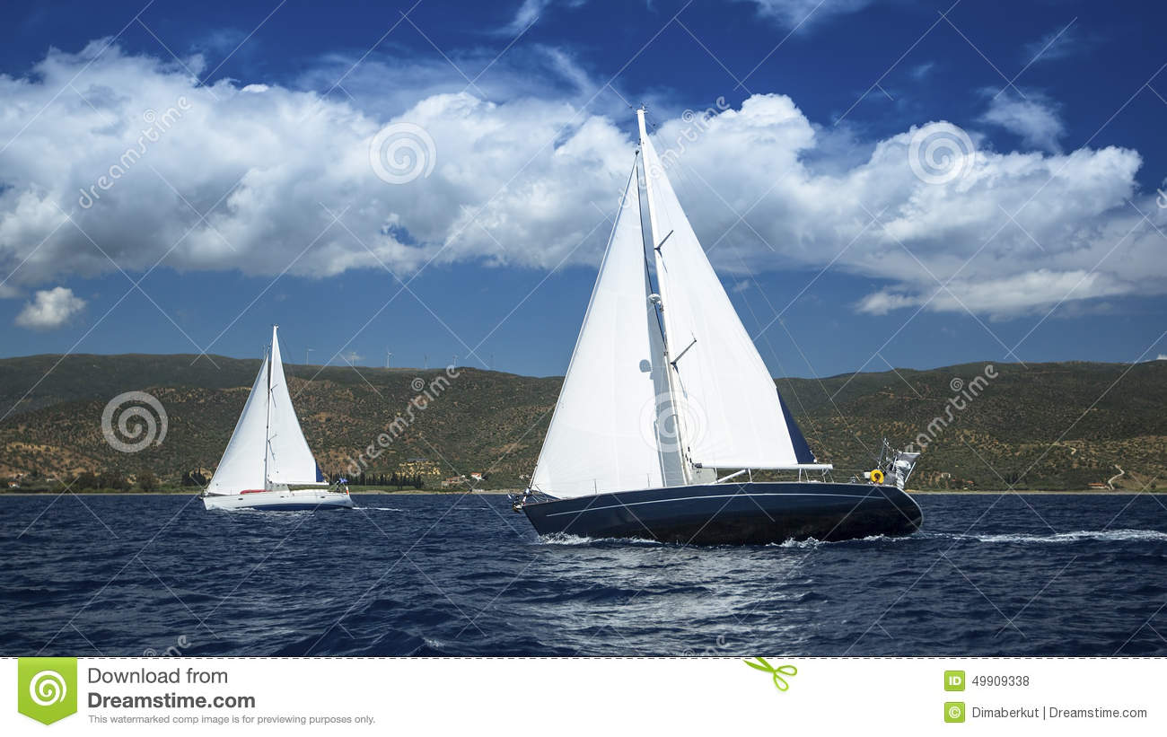 Sailboats in sailing regatta. Sailing. Yachting in cloudy weather.