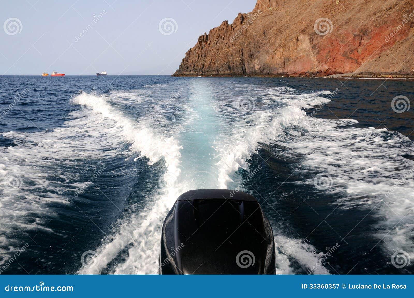 Sailing the blue sea on a boat outboard