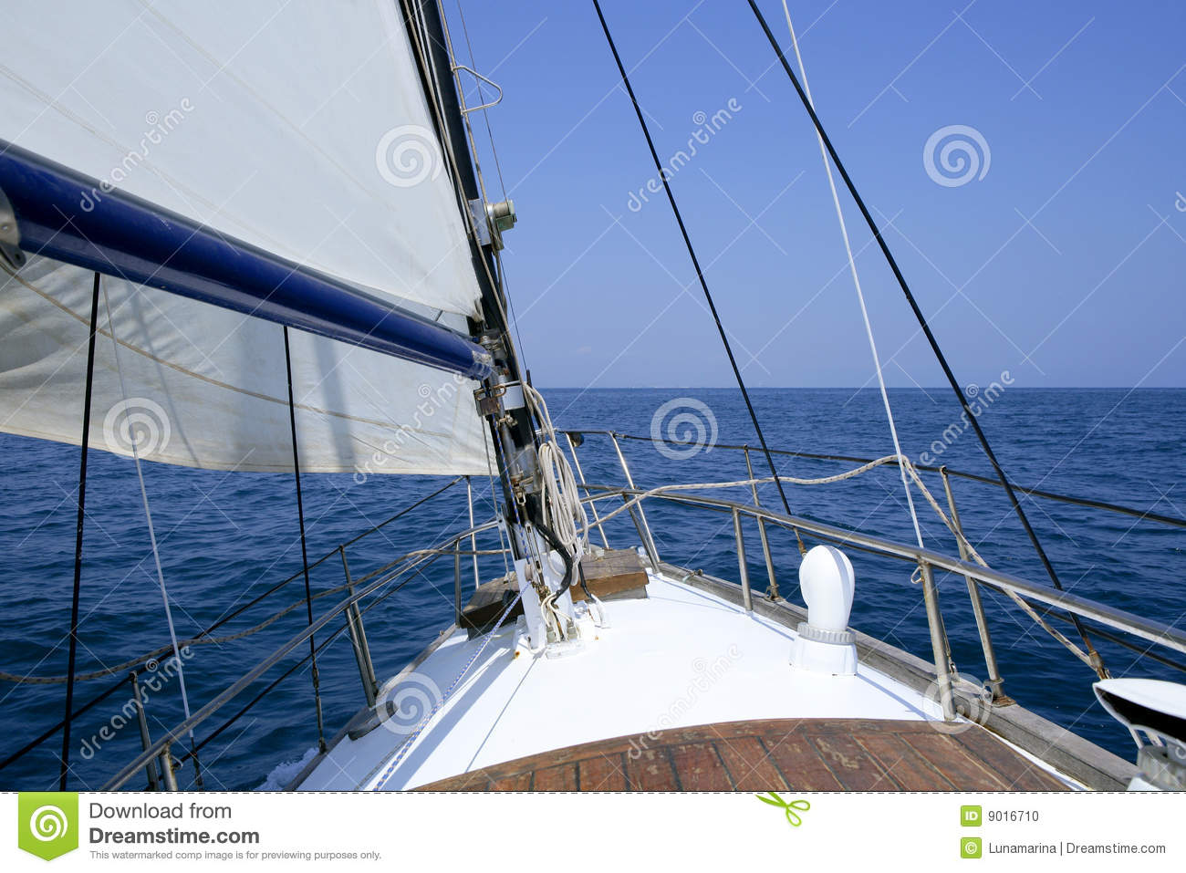 Sailing with an old sailboat over blue mediterranean summer sea.