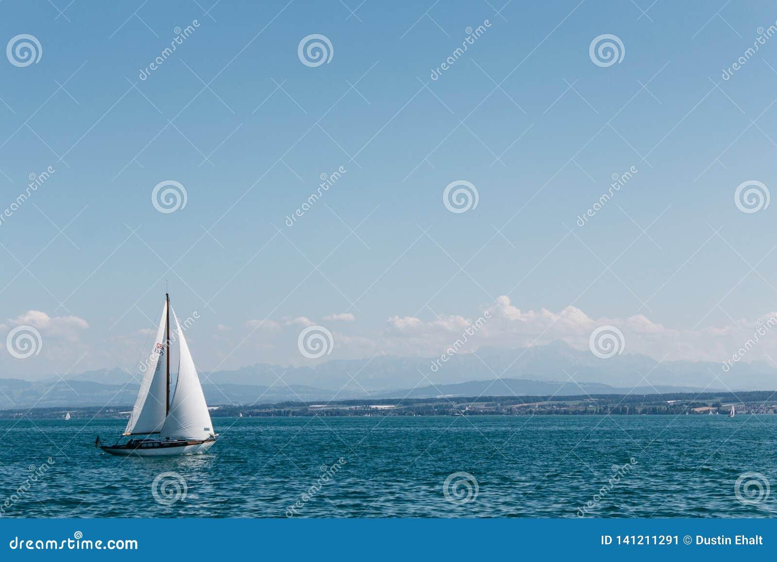 Sailing on the sea under blue skies