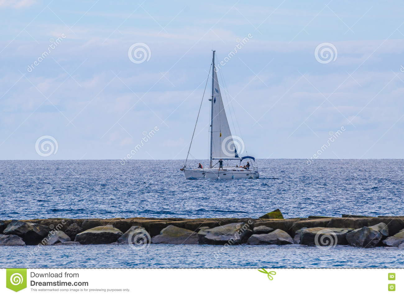 Sailing ship yachts with white sails in the open Sea. Luxury boa