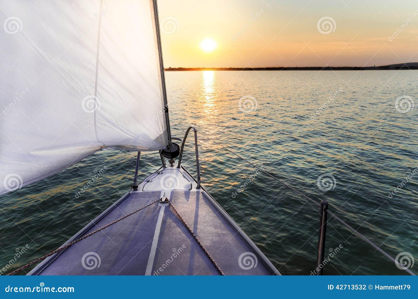 sunset sailing boats rocks - photo #24