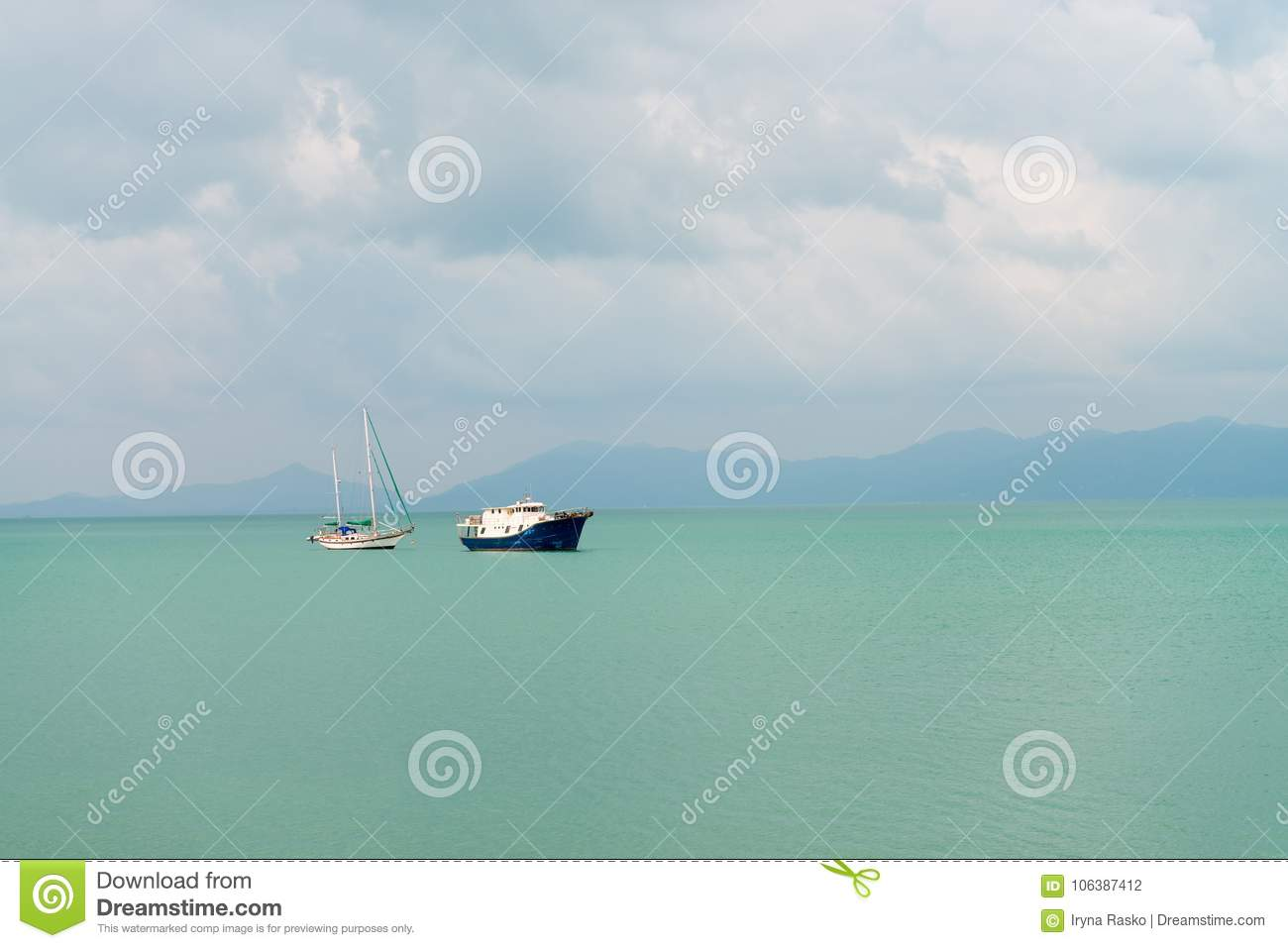 Sailing yacht and motor boat in the sea
