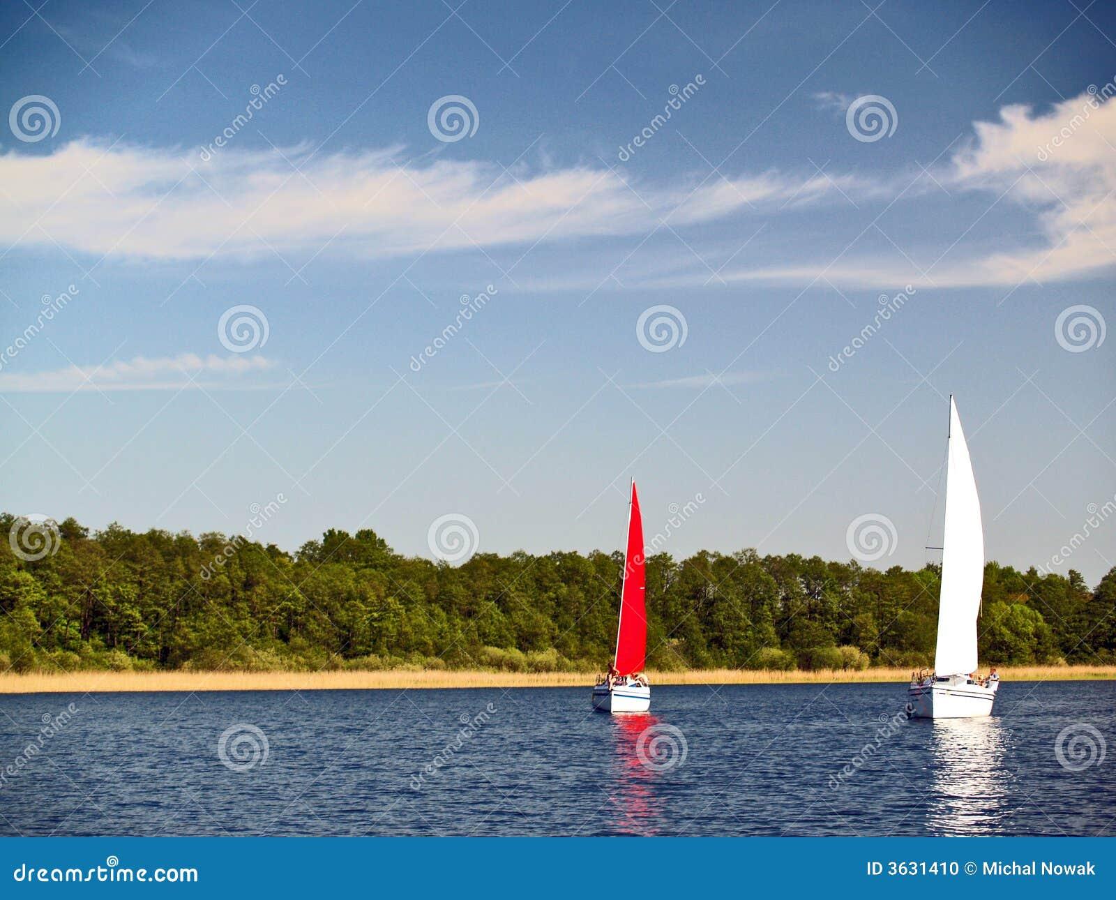 Sailing yachts on lake