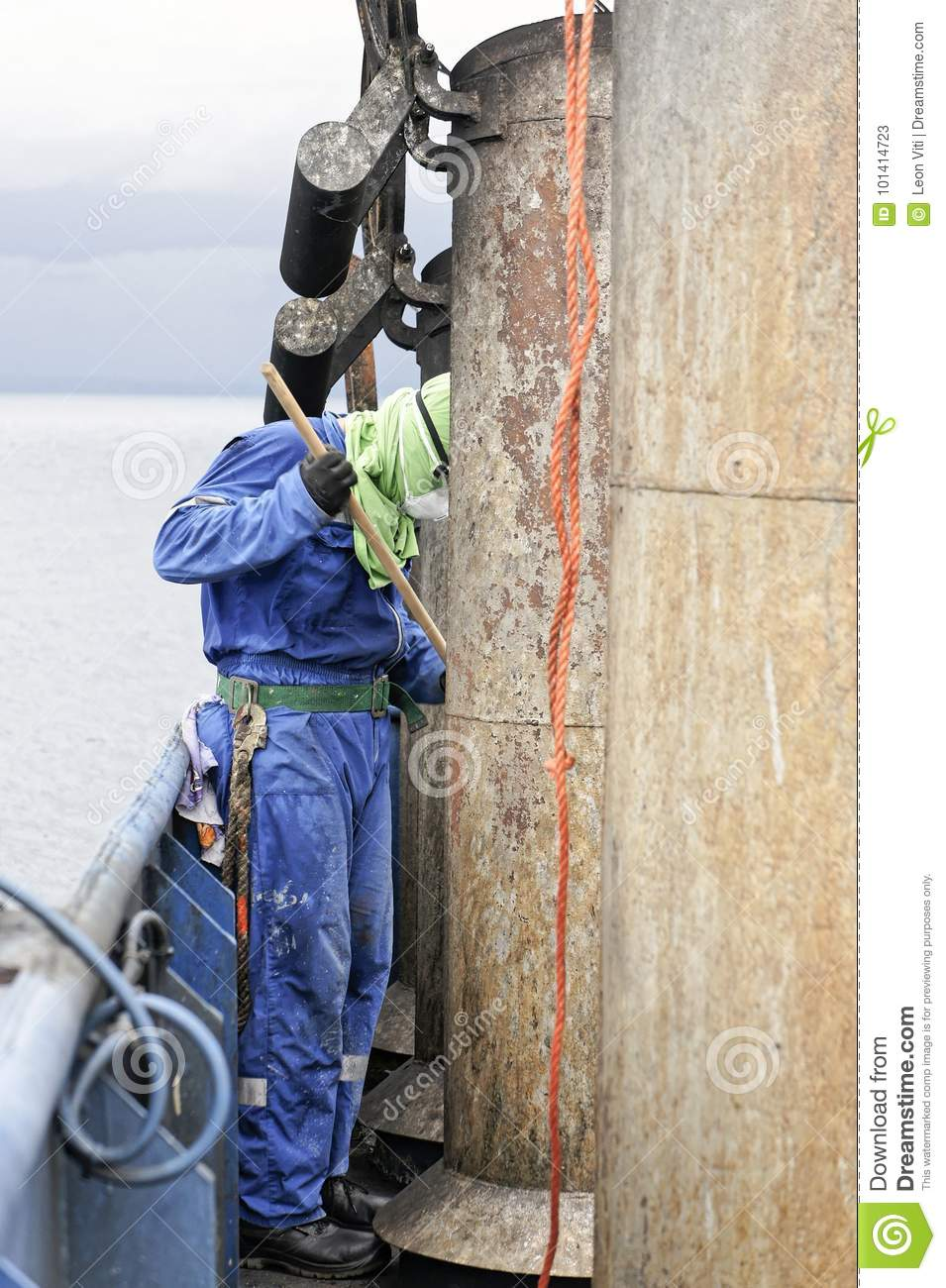 sailor paint old rusty pipe on top a funnel editorial stock photo