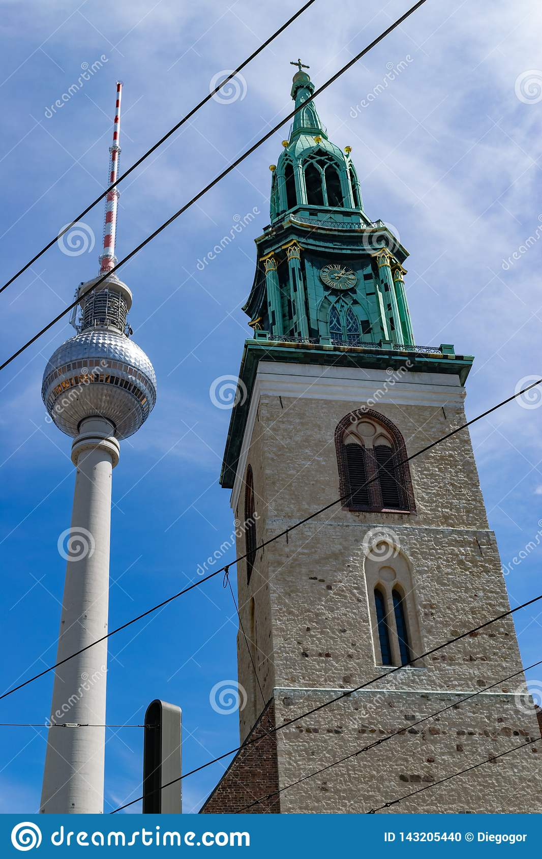 Lutheran Saint Mary`s church in Berlin in contrast with the needle tower of communications