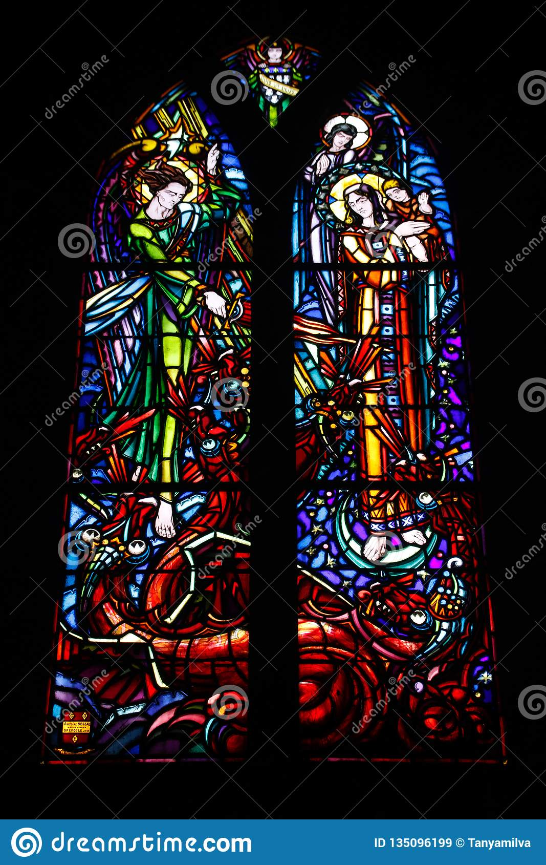 Multicolored beautiful stained glass windows in the main gothic cathedral of France