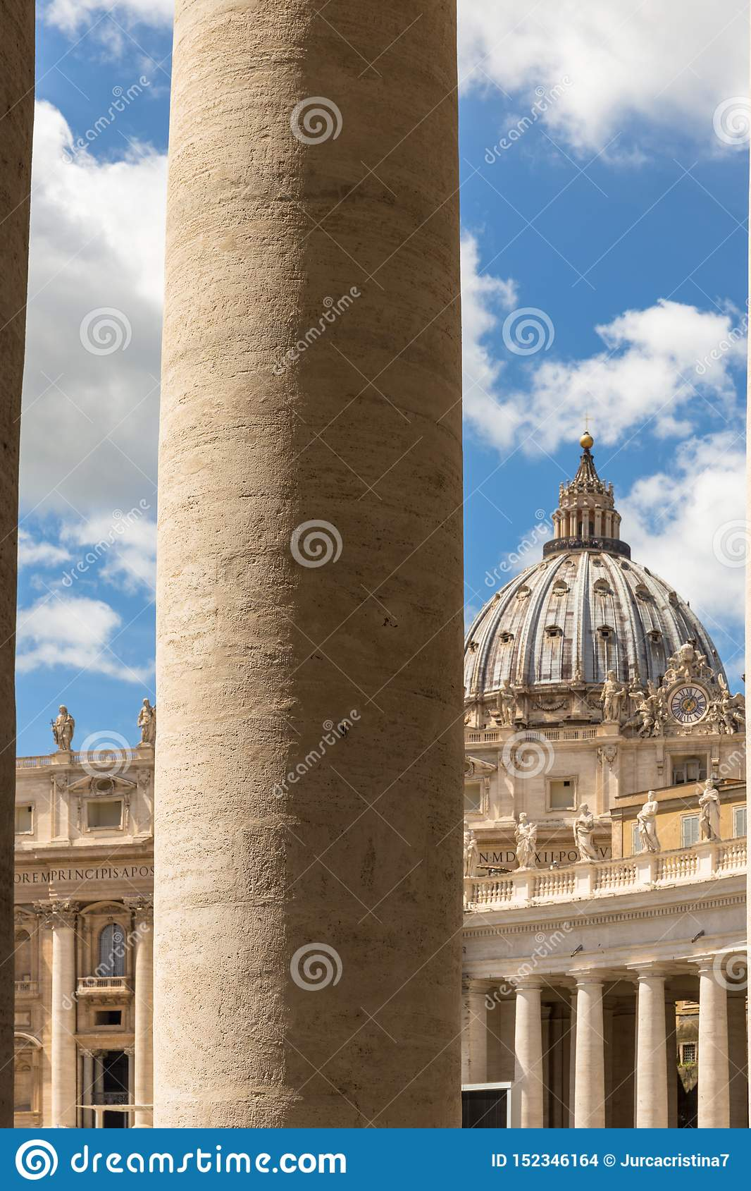 Saint Peter`s Dome seen through the Bernini Colonnade in St. Peter`s Square, Doric column detail.