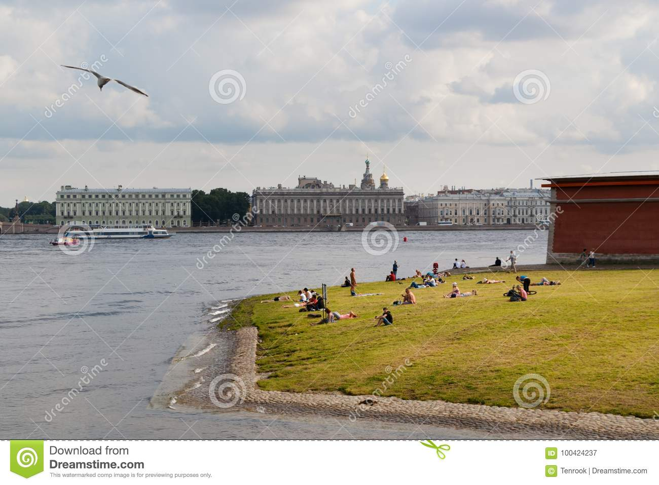 SAINT PETERSBURG, RUSSIA - AUGUST 18, 2017: People resting on the banks of the Neva river at the Peter-Paul fortress