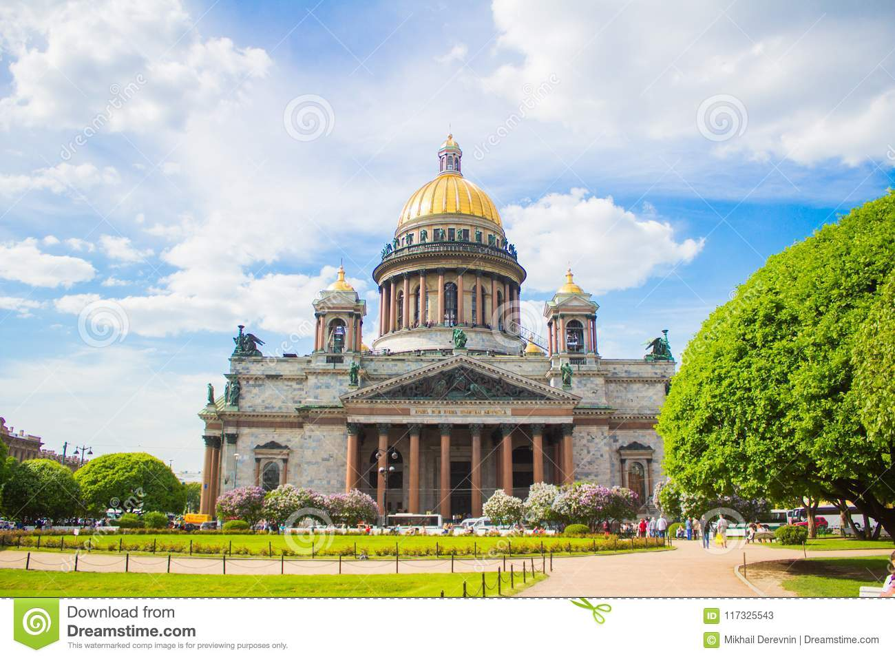 Saint Isaac`s Cathedral in the flowers of lilac and Apple trees