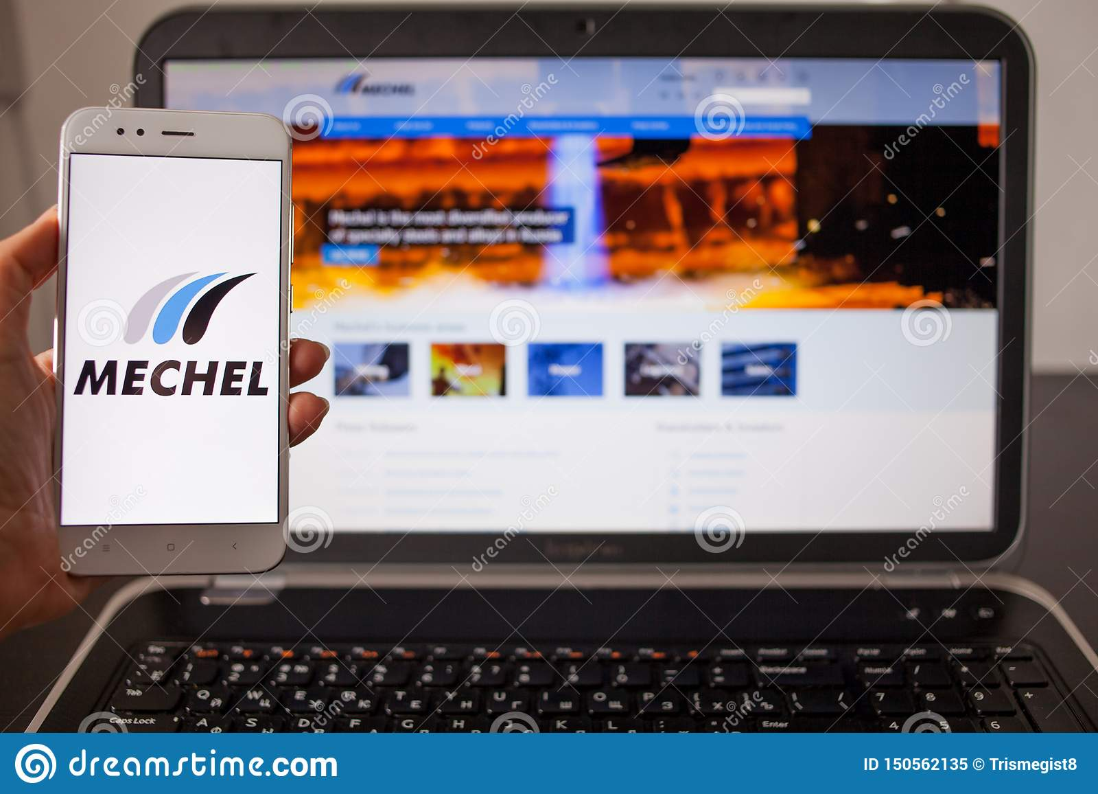 SAINT PETERSBURG, RUSSIA - MAY 14, 2019: Website and logo of the Russian company Mechel on the screens of gadgets