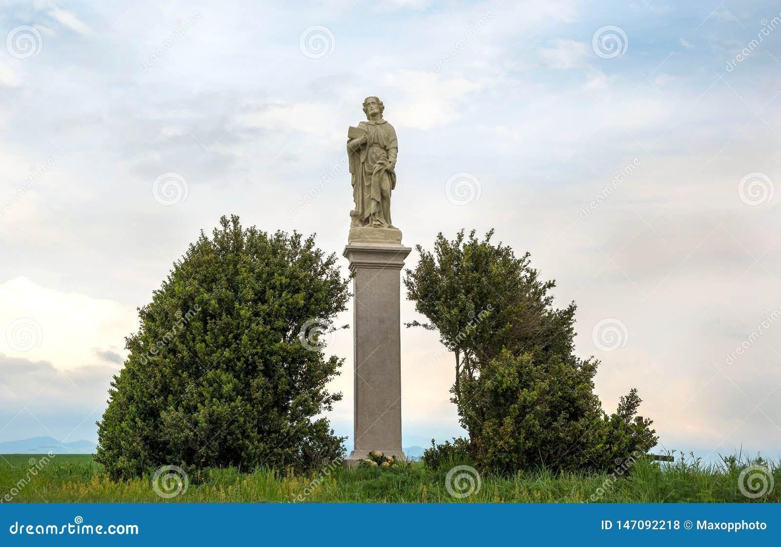Saint Roch or Rocco statue. Catholic saint a confessor