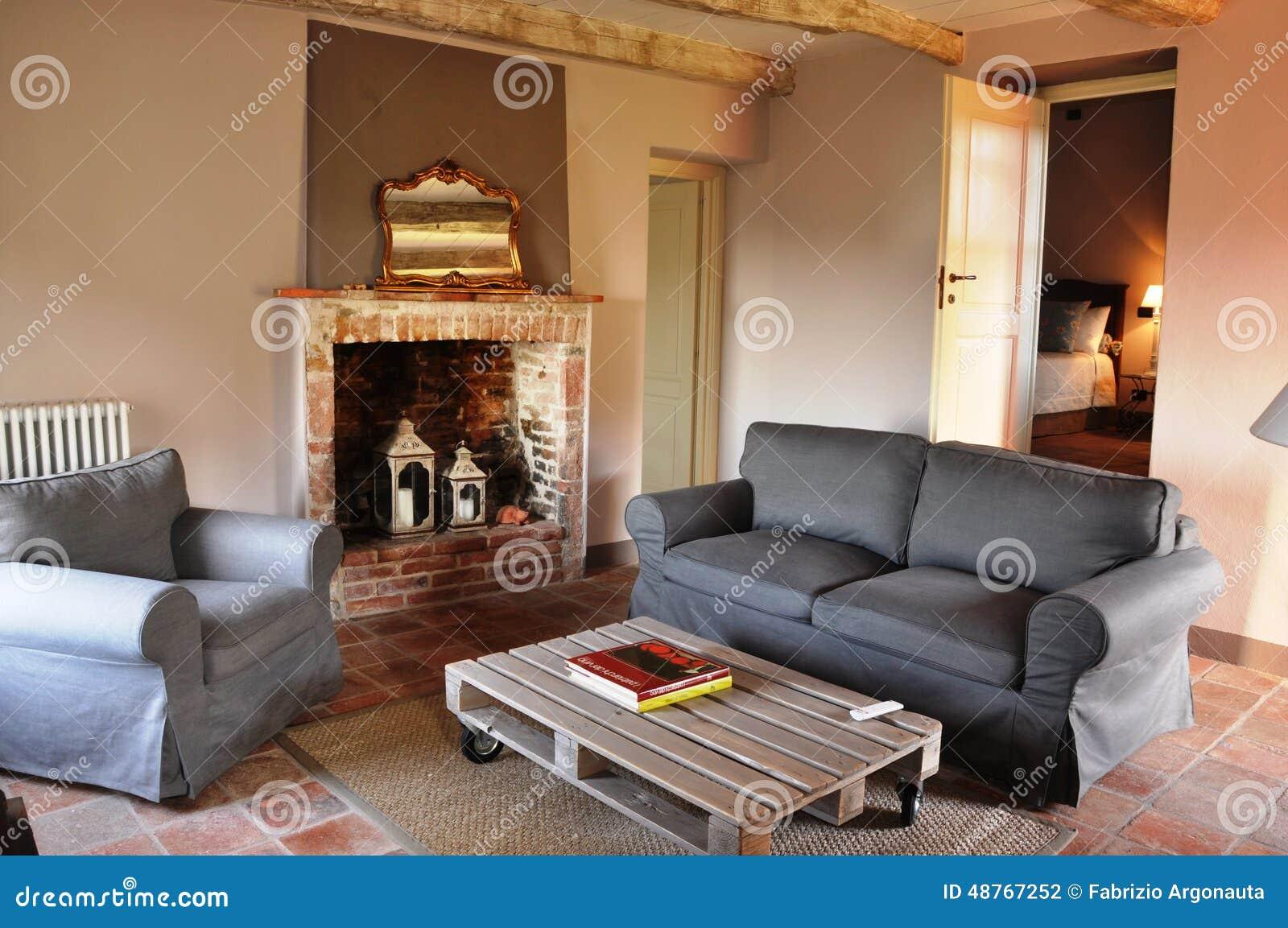 Sala de estar do estilo da casa de campo foto de stock for Estilos de apartamentos