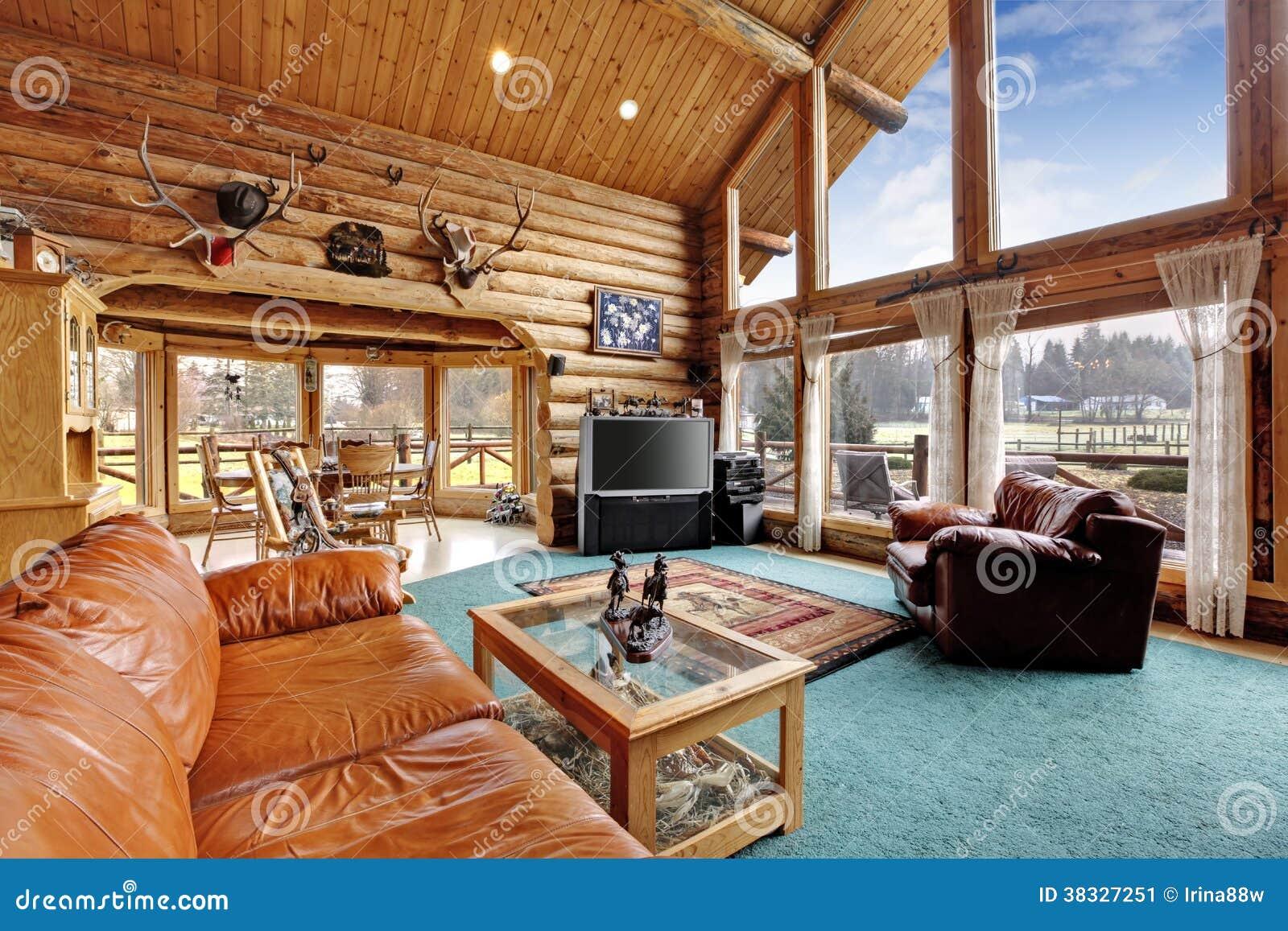 Sala de estar grande con rea diining en casa de la caba a for Sala de estar madera