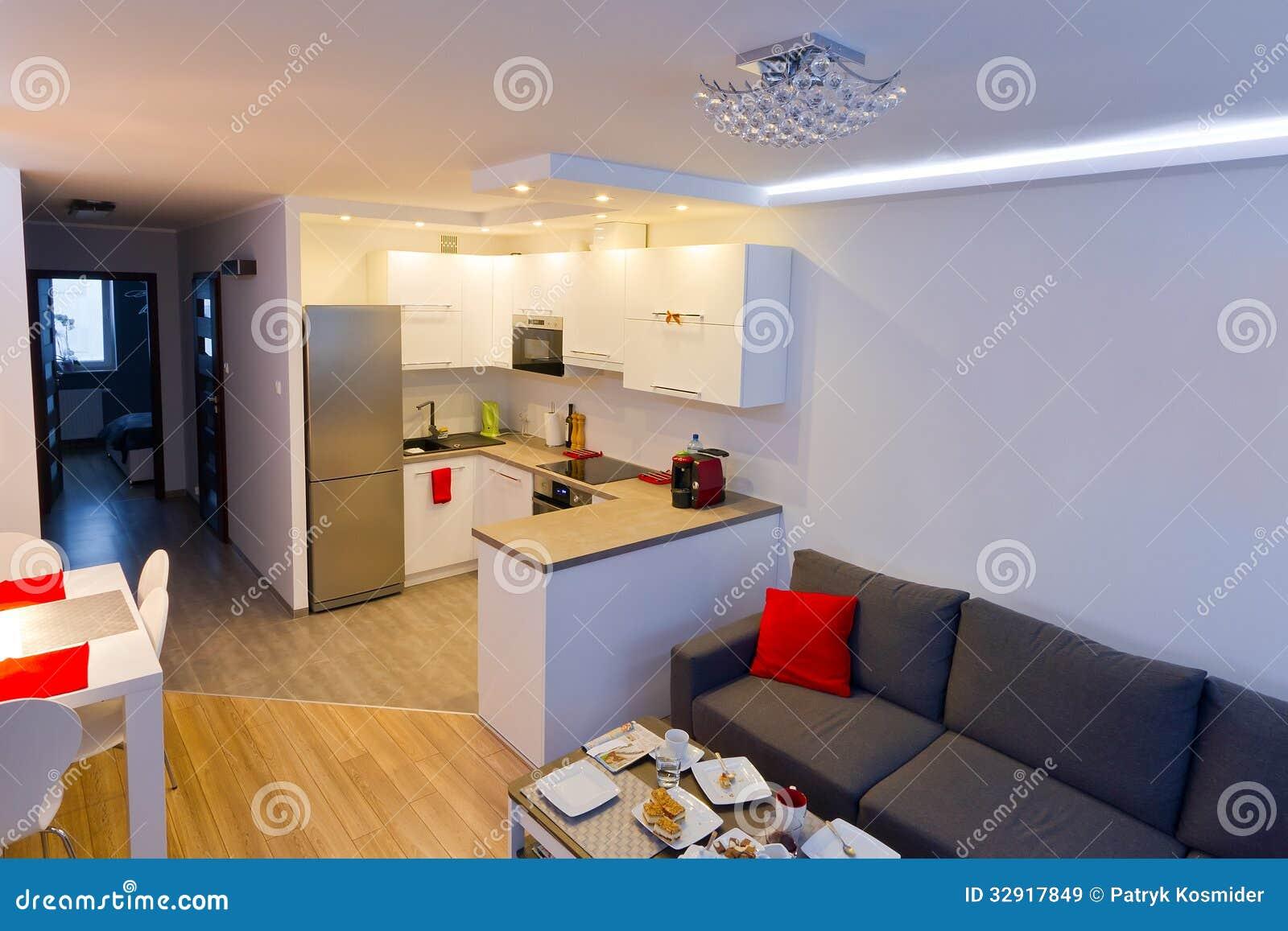 sala de estar moderna con la cocina imagen de archivo