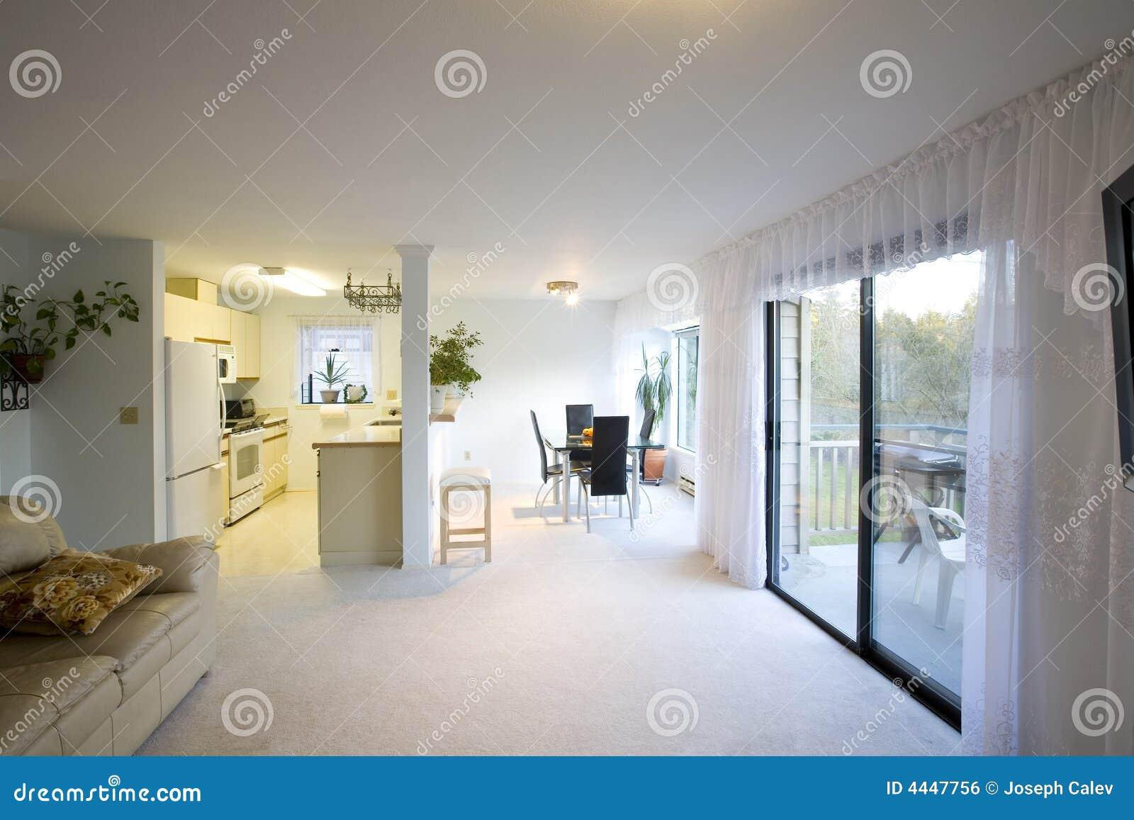 Uma sala de jantar uma cozinha e uma sala de visitas encenadas em um  #81A229 1300x957