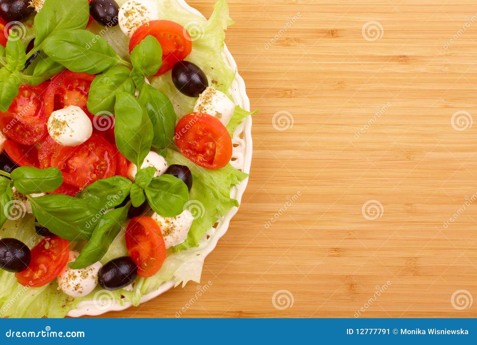 Tomato, Olive, And Fresh Mozzarella Salad With Basil Vinaigrette ...