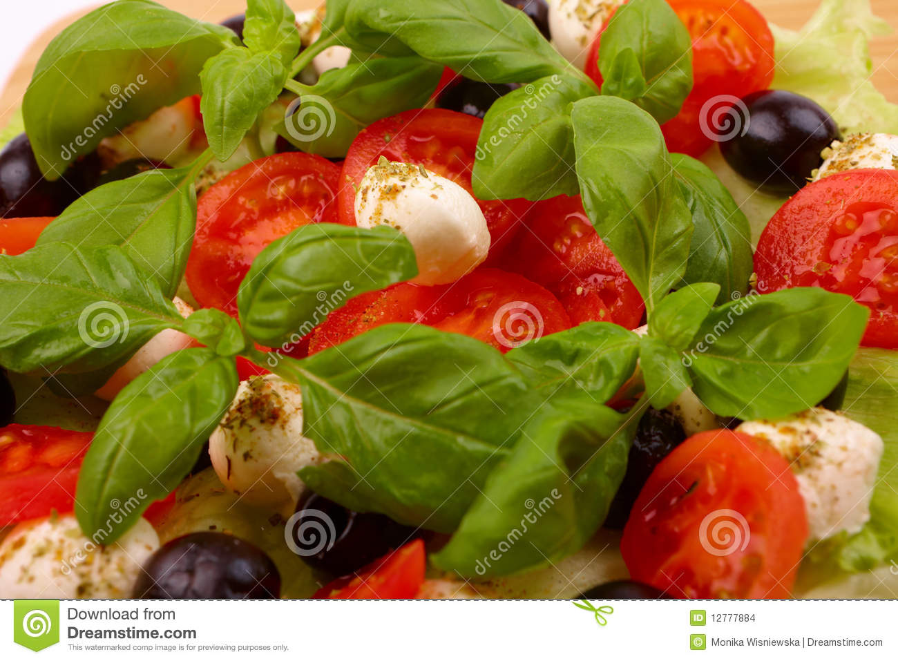 Salad With Basil, Mozzarella, Olives And Tomato Stock Images - Image ...
