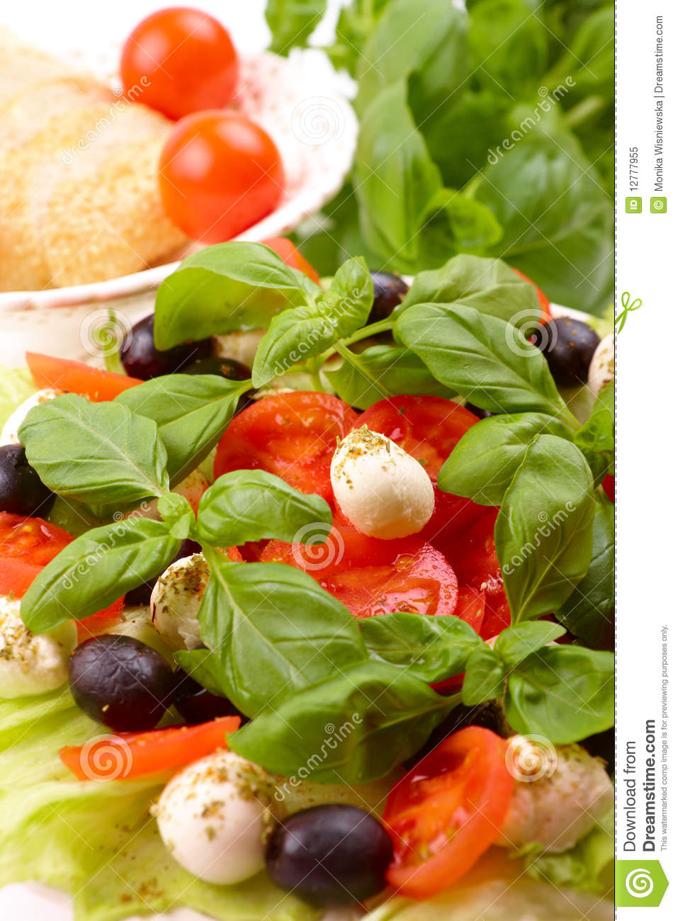 Salad With Basil, Mozzarella, Olives And Tomato Royalty Free Stock ...