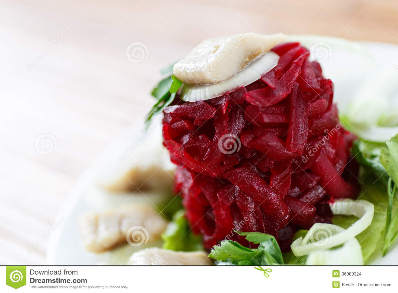 Salad with boiled beet and herring with lettuce leaves.