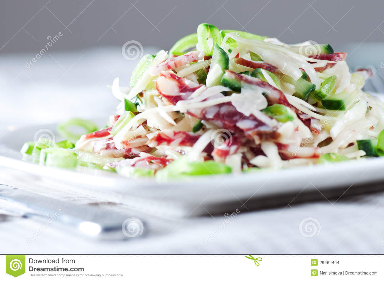 Stock Images: Salad with cabbage , sausage, cucumber and green peas ...