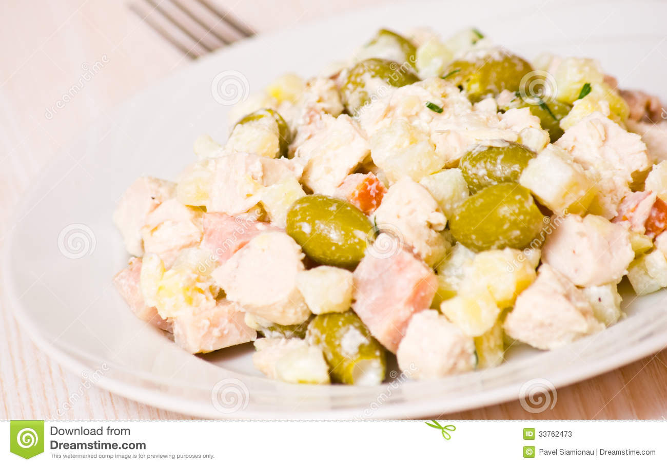 Stock Photos: Salad with chicken, ham, potatoes and olives