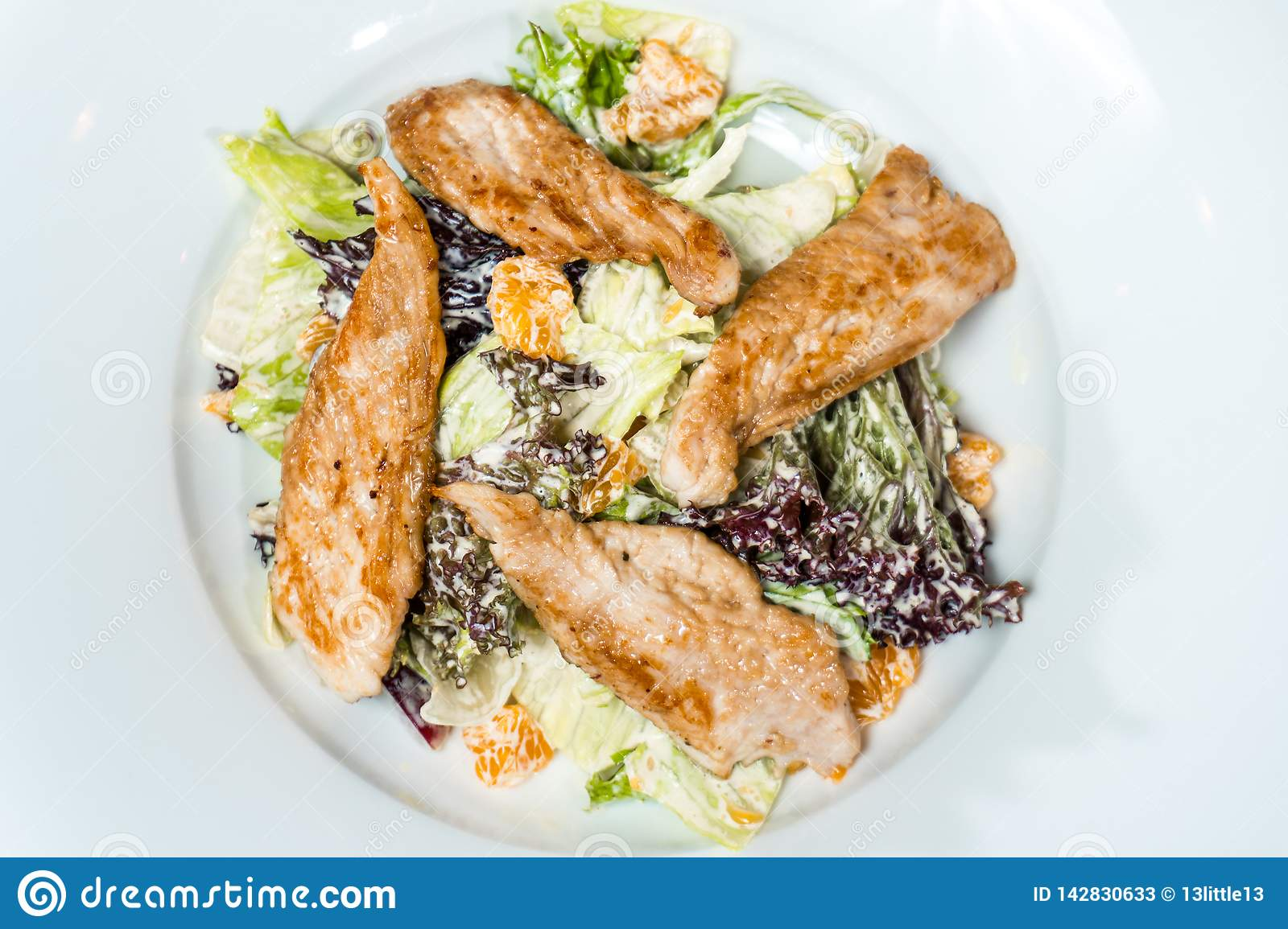Salad with chicken meat cream sauce