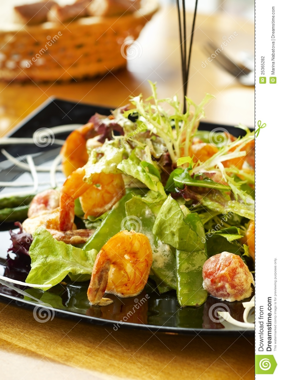 Salad with green peas, cherry tomatoes, shrimps and cheese.