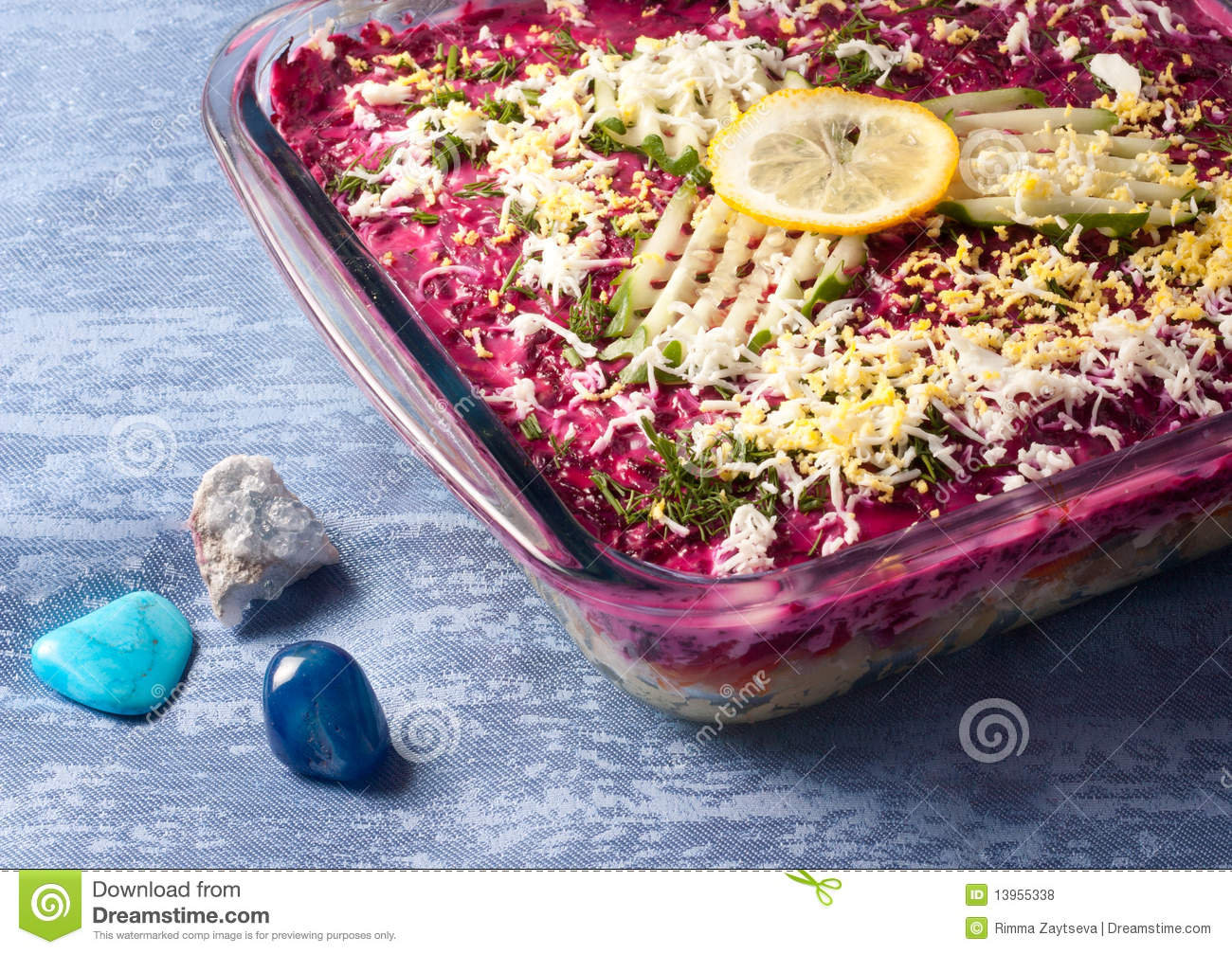 Salad of herring and vegetables on the blue.