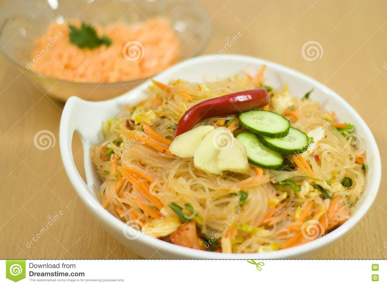 Salad of korean noodle in the white bowl