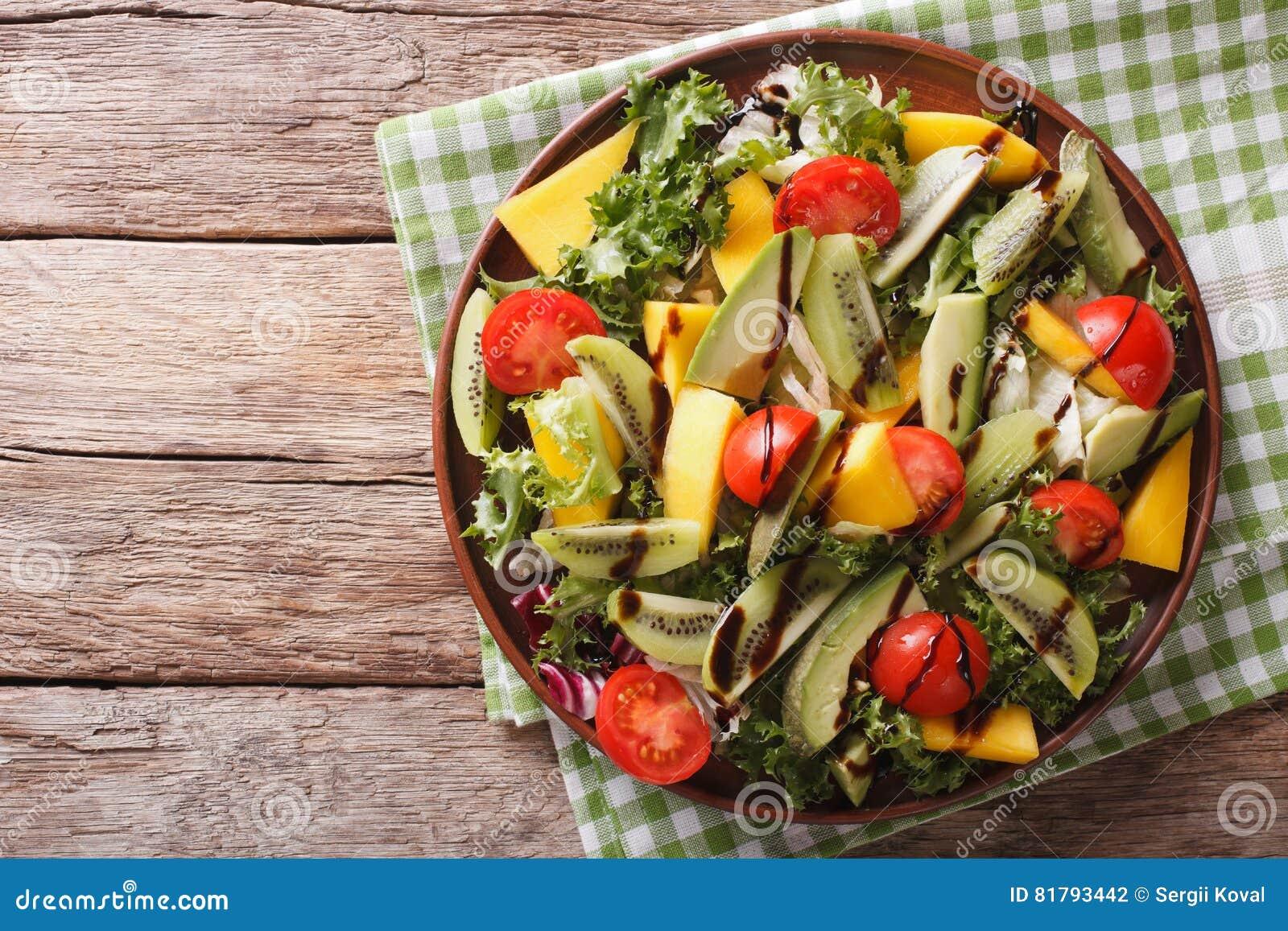 Salad Of Mango Avocado Kiwi Lettuce Tomato Dressed With Bals