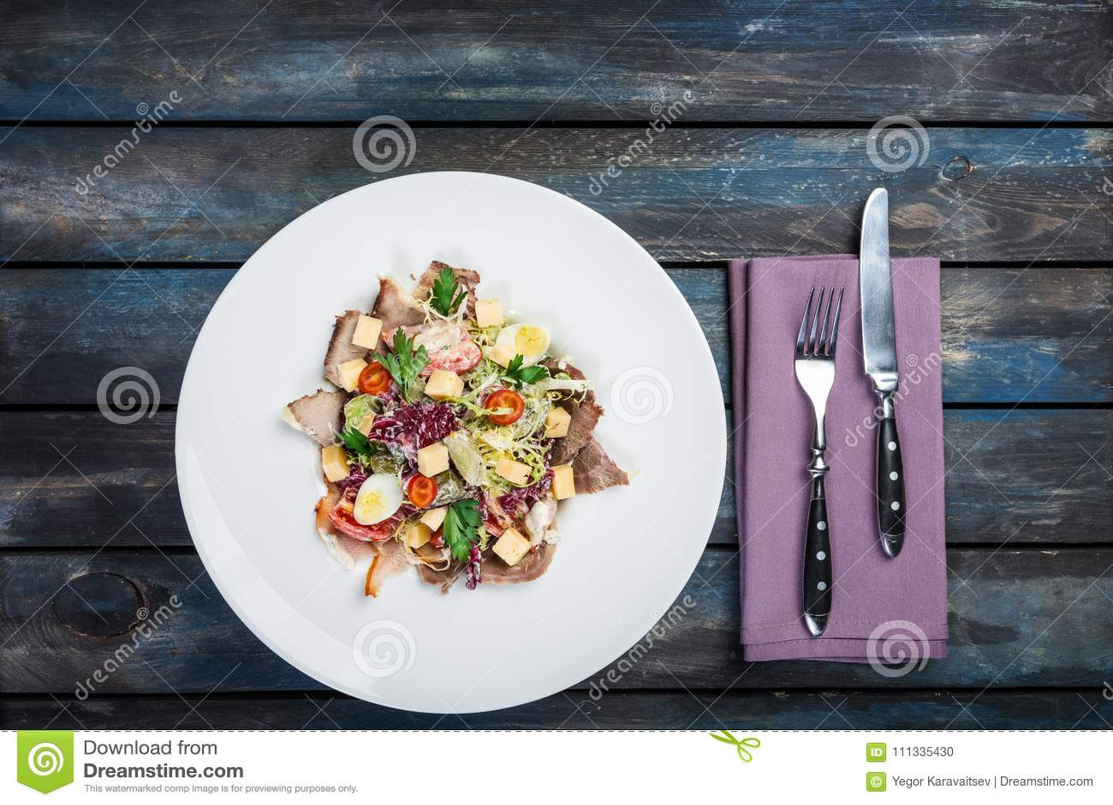 Salad. Mixed lettuce, tomatoes, turkey smoked, smoked duck, dried horsemeat